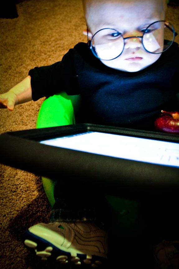 Baby Steve Jobs playing on his iPad